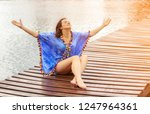 happy woman on the beach | Shutterstock . vector #1247964361