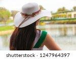 beautiful woman in white hat... | Shutterstock . vector #1247964397