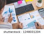 business team meeting working... | Shutterstock . vector #1248031204