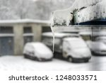 snow covered cars in the winter ... | Shutterstock . vector #1248033571