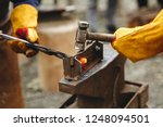 the blacksmith's anvil is made... | Shutterstock . vector #1248094501