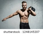 young muscular man training... | Shutterstock . vector #1248145207