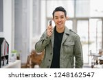a young  confident and good... | Shutterstock . vector #1248162547