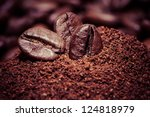 Coffee Beans On Grunge Wooden...
