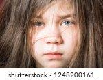 sad shaggy girl.   Shutterstock . vector #1248200161