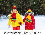 kids playing in snow. children... | Shutterstock . vector #1248228757
