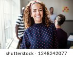 young female designer smiling... | Shutterstock . vector #1248242077