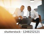 two diverse businessmen smiling ... | Shutterstock . vector #1248252121
