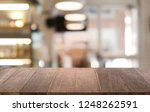 empty dark wooden table in... | Shutterstock . vector #1248262591