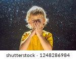 Allergy to dust. boy sneezes...