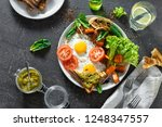 breakfast table. fried eggs... | Shutterstock . vector #1248347557