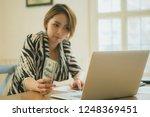 online payment man and woman ... | Shutterstock . vector #1248369451