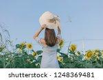 beautiful woman in the field... | Shutterstock . vector #1248369481