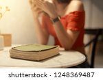 woman with book in living room | Shutterstock . vector #1248369487