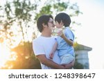 asian father and son playing... | Shutterstock . vector #1248398647