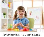 kid's creativity. child sculpts ... | Shutterstock . vector #1248453361