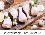 raw chicken legs with spices... | Shutterstock . vector #1248482587