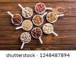 mix of nuts   pistachios ... | Shutterstock . vector #1248487894