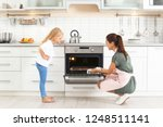 young woman and her daughter... | Shutterstock . vector #1248511141