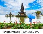 a girl under the umbrella  ulun ...   Shutterstock . vector #1248569197