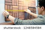 young asian man worker using... | Shutterstock . vector #1248584584
