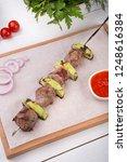 grilled meat on metal skewer...   Shutterstock . vector #1248616384