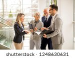mature and young businesswoman... | Shutterstock . vector #1248630631