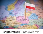 Stock photo poland marked with a flag on the map 1248634744