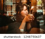 asian woman drinking coffee in  ...   Shutterstock . vector #1248750637