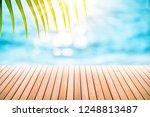 blur tropical beach with bokeh... | Shutterstock . vector #1248813487