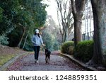 woman walking with a dog | Shutterstock . vector #1248859351