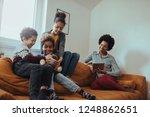 mother using digital tablet... | Shutterstock . vector #1248862651