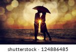 couple kissing under umbrella... | Shutterstock . vector #124886485