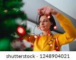 woman wearing yellow shirt... | Shutterstock . vector #1248904021