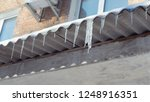 big melting icicles hang from... | Shutterstock . vector #1248916351
