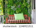 swing made of wood with green...   Shutterstock . vector #1248921511