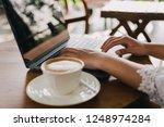 asian woman drinking coffee in...   Shutterstock . vector #1248974284