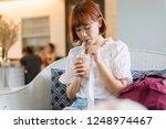 beautiful asian woman drinks...   Shutterstock . vector #1248974467