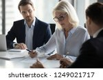 businessmen sitting at desk... | Shutterstock . vector #1249021717
