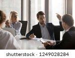 serious businessmen... | Shutterstock . vector #1249028284