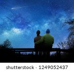 couple watching the stars in... | Shutterstock . vector #1249052437