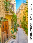 the narrow street with old low... | Shutterstock . vector #1249172617