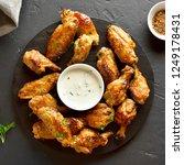 tasty grilled chicken wings... | Shutterstock . vector #1249178431