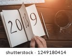 top view of notepad on wooden... | Shutterstock . vector #1249180414