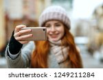 joyful red head woman in winter ... | Shutterstock . vector #1249211284