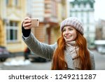 cheerful red head model in... | Shutterstock . vector #1249211287