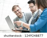 close up. employees discussing... | Shutterstock . vector #1249248877