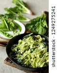 green fettuccine pasta with... | Shutterstock . vector #1249275241