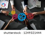 business team connect pieces of ... | Shutterstock . vector #1249321444