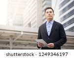 business man and tablet with... | Shutterstock . vector #1249346197